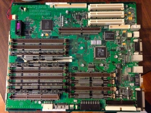 To replace the Power Macintosh 8500's on-board battery (upper left corner of photo), you have to remove the motherboard.