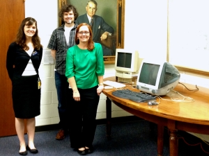 Wendy Hagenmaier, Jason W. Ellis, and Jody Thompson next to Apple Performa 550 and iMac.