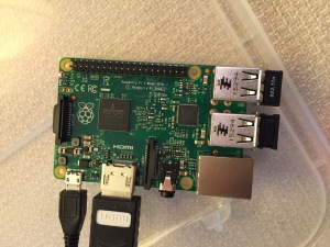 The Raspberry Pi connected from left to right: micro USB power input from 5v power supply, HDMI, wireless keyboard/trackpad receiver, and wifi adapter.