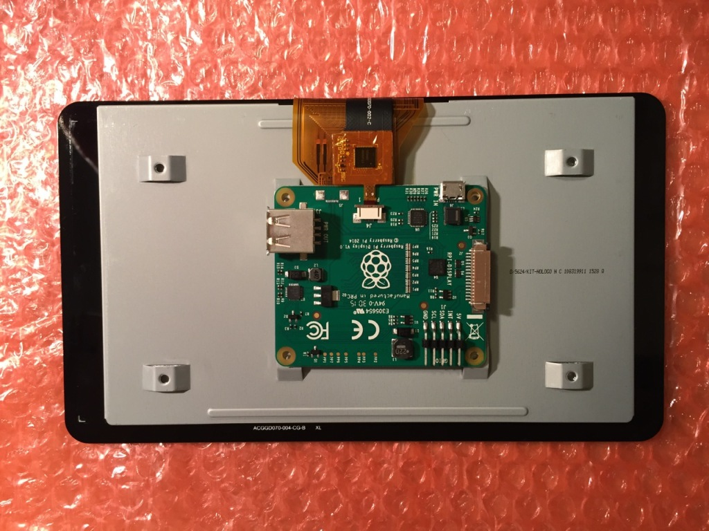 """To begin connecting the 7"""" Touchscreen Display to the Raspberry Pi, place the screen facing down."""