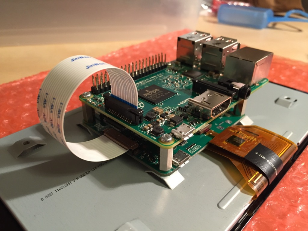 Connect the other end of the display cable into the output connector on the Raspberry Pi.