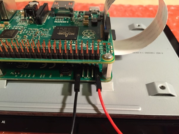 Use the supplied jumper wires to connect connect the power input of the display controller card...