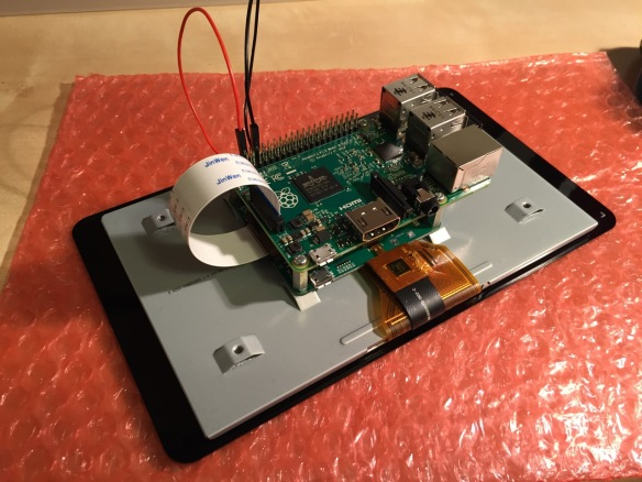 """This is the rear of the 7"""" Touchscreen Display assembled with the controller card and Raspberry Pi."""